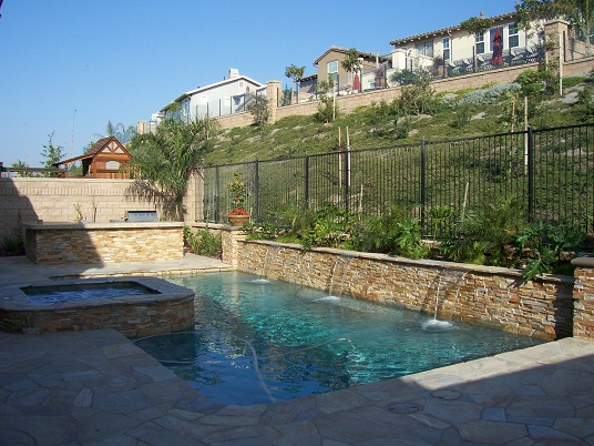 This Swimming pool was built in Orange County it includes stack stone, pour in place coping, pebble tec, and water features.